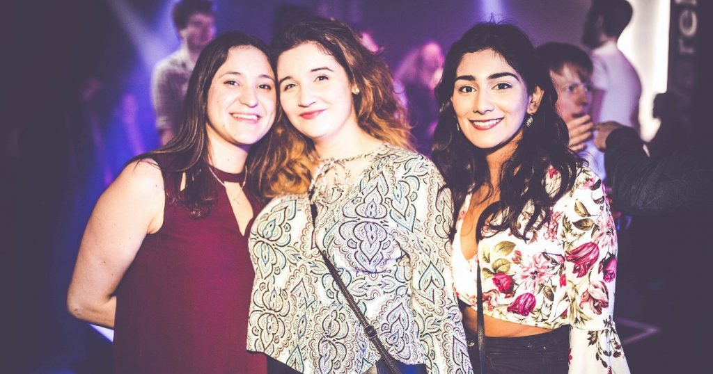 Image may contain: Smile, Portrait, Face, Night Life, Night Club, Club, Person, People, Human