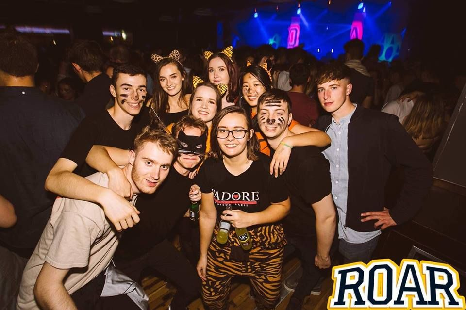 Image may contain: Crowd, Smile, Face, Night Club, Club, Night Life, Party, Human, Person