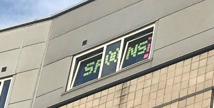 Image may contain: Scoreboard, Symbol, Brick