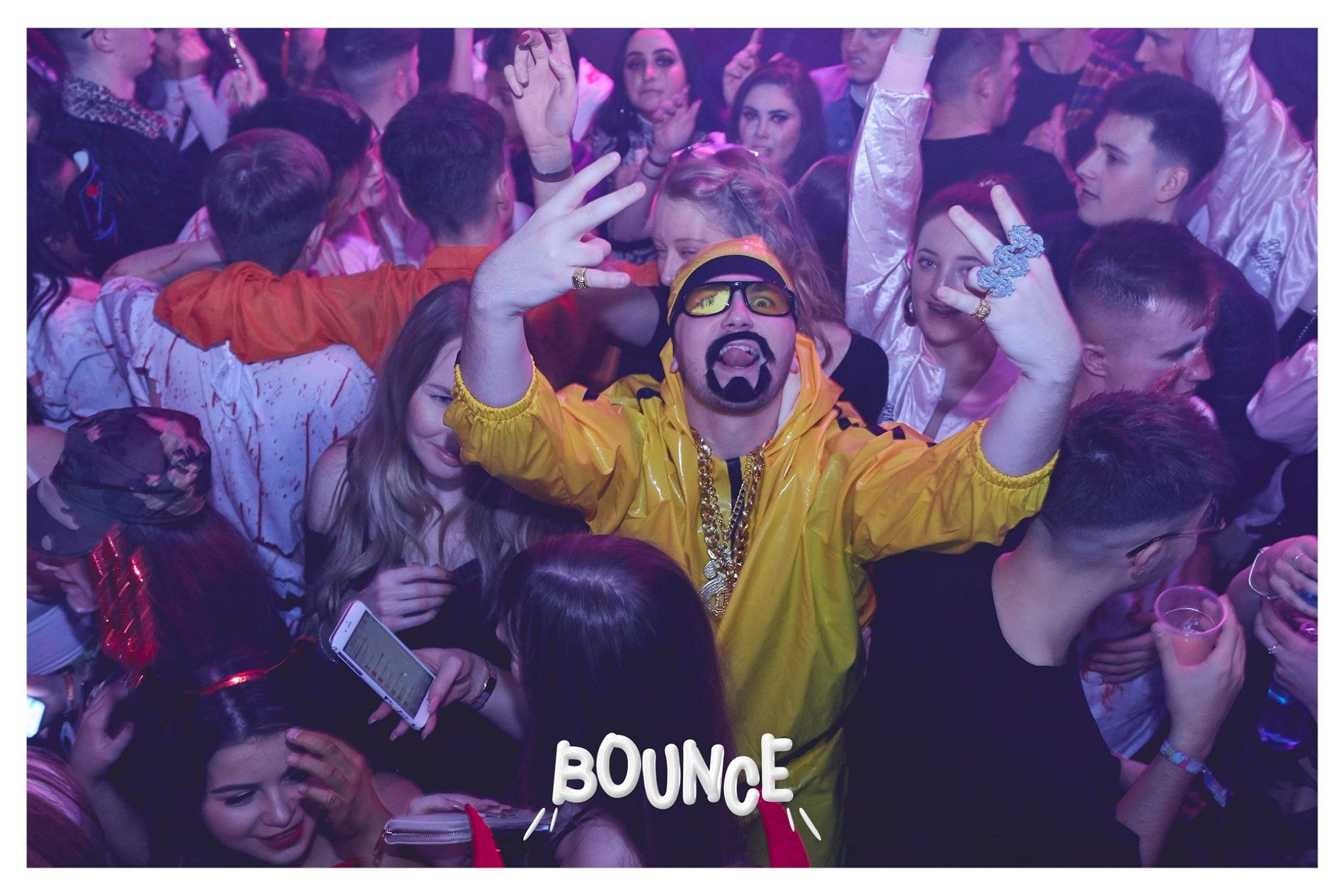 Image may contain: Leisure Activities, Crowd, Sunglasses, Accessories, Accessory, Night Club, Club, Party, Human, Person