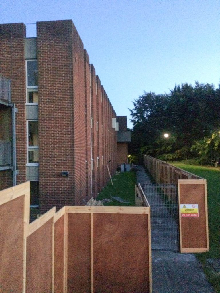 Wooden hoardings have been put up around Mantell building, former home of Sussex's International Study Centre