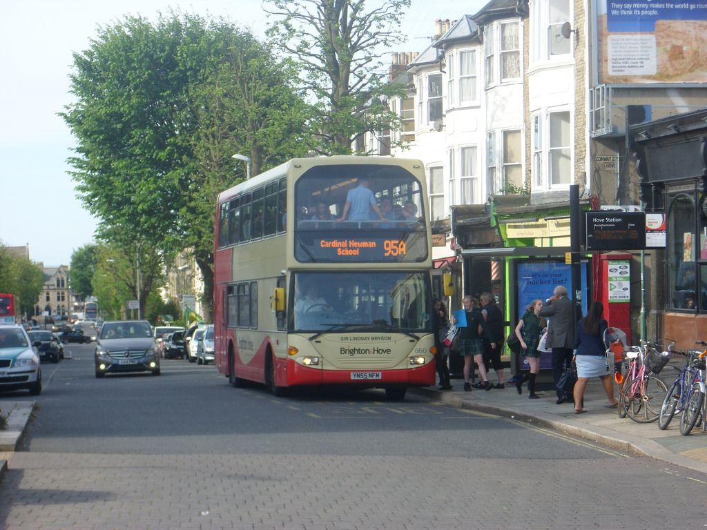 Image may contain: Tour Bus, Bus Stop, Wheel, Machine, Bike, Bicycle, Automobile, Car, Human, Person, Transportation, Vehicle, Bus