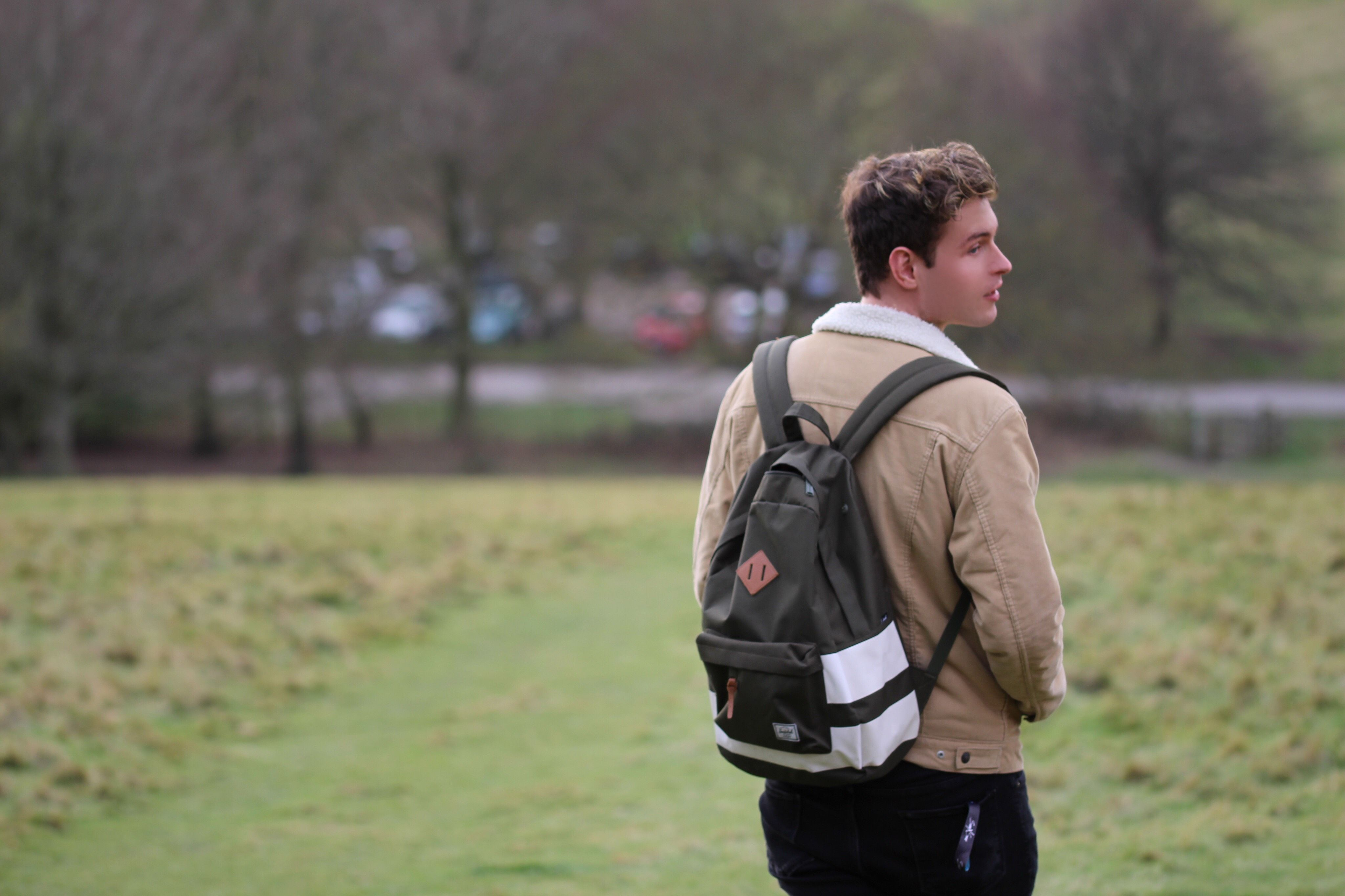 Image may contain: Backpack, Bag, Apparel, Clothing, Human, Person