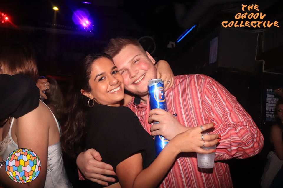 Image may contain: Night Life, Can, Club, Tin, Party, Human, Person