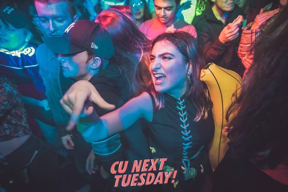 Image may contain: Disco, Apparel, Hat, Clothing, Night Club, Club, Party, Human, Person
