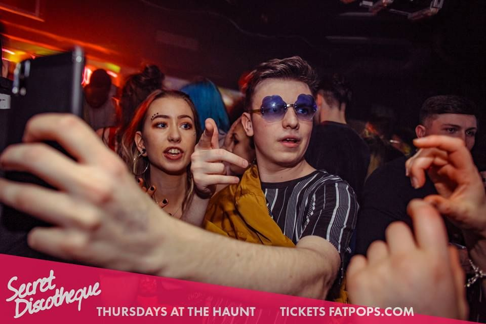Image may contain: Night Life, Night Club, Club, Accessory, Sunglasses, Accessories, Party, Person, Human