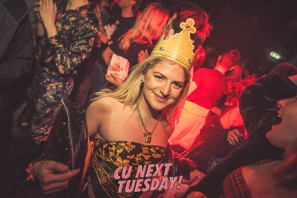 Image may contain: Party Hat, Hat, Night Life, Apparel, Clothing, Night Club, Club, Human, Person, Party