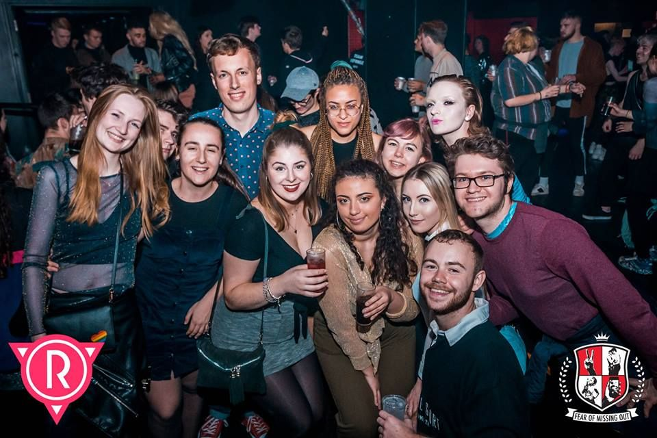 Image may contain: People, Apparel, Footwear, Clothing, Shoe, Audience, Crowd, Accessories, Glasses, Accessory, Face, Night Life, Night Club, Club, Person, Human, Party