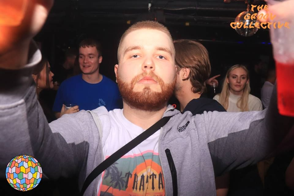 Image may contain: Photo, Photography, Portrait, Crowd, Club, Apparel, Clothing, Man, Night Life, Beard, Party, Indoors, Interior Design, Human, Person, Face
