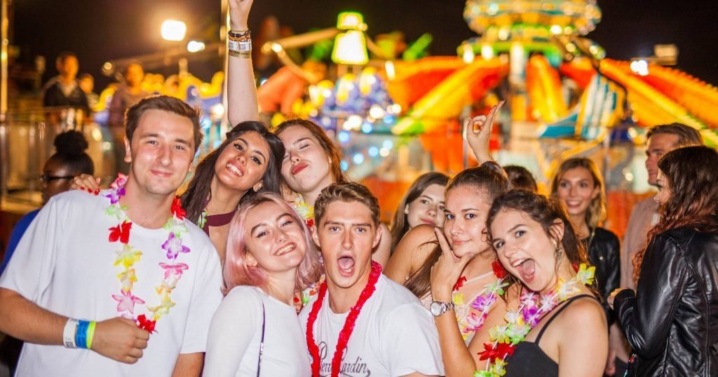 Image may contain: Face, Leisure Activities, Crowd, Tourist, Vacation, Night Life, Party, Person, Human