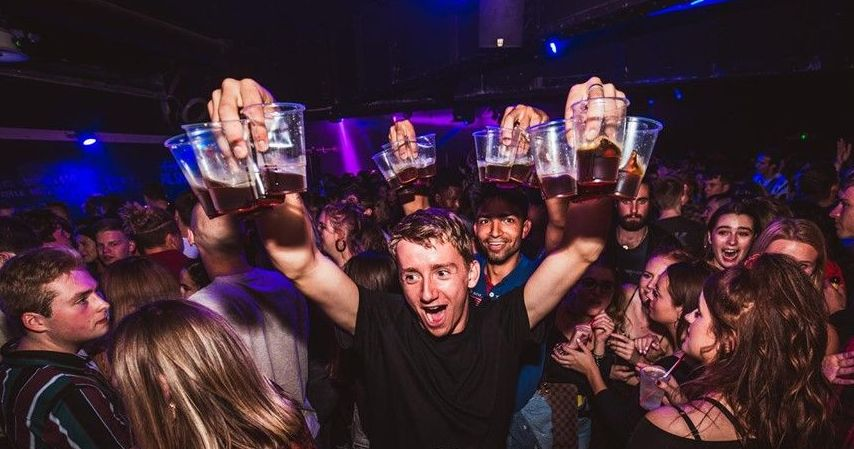 Image may contain: Glass, Disco, Lighting, Night Life, Night Club, Club, Party, Human, Person