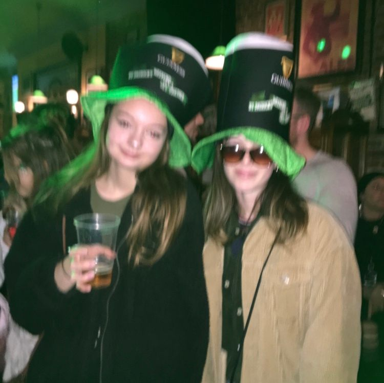 Image may contain: Female, Alcohol, Bar Counter, Head, Pub, Smile, Night Club, Drink, Beverage, Hat, Club, Face, Party, Night Life, Accessories, Accessory, Sunglasses, Apparel, Clothing, Human, Person