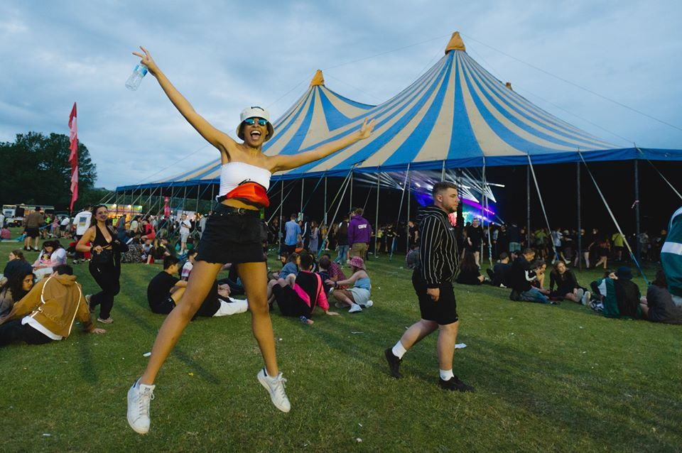 Image may contain: Girl, People, Leisure Activities, Woman, Shorts, Tent, Festival, Crowd, Female, Clothing, Apparel, Person, Human