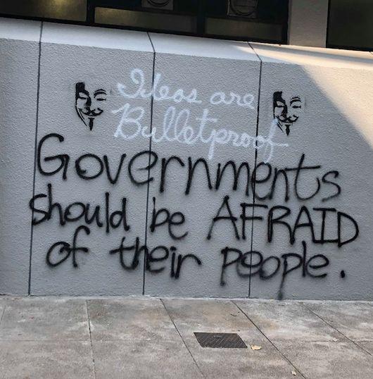 Image may contain: Text, Graffiti, Wall