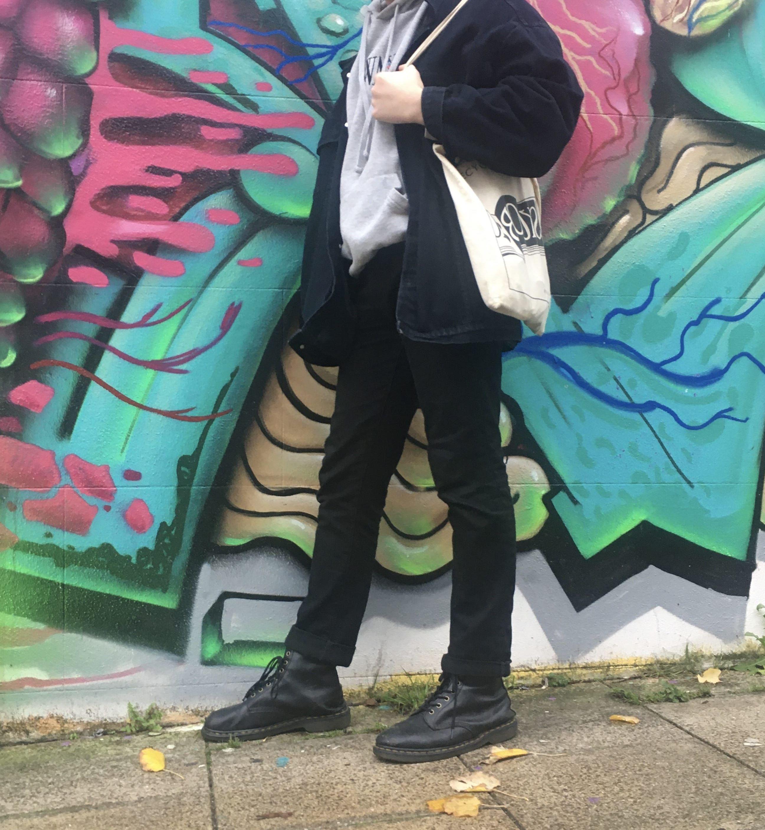 Image may contain: Wall, Painting, Mural, Person, Human, Art, Graffiti, Clothing, Shoe, Apparel, Footwear