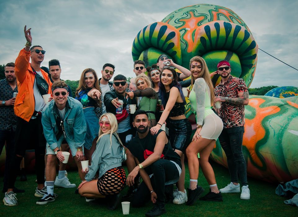 Image may contain: Woman, Girl, Shorts, Portrait, Photography, Photo, Coat, People, Grass, Plant, Female, Crowd, Accessory, Accessories, Sunglasses, Face, Costume, Shoe, Footwear, Person, Human, Apparel, Clothing