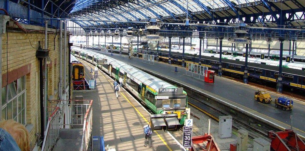 Image may contain: Rail, Train Track, Railway, Human, Person, Train, Vehicle, Train Station, Terminal, Transportation