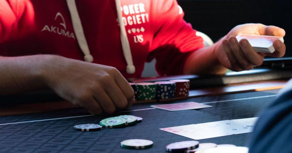 Image may contain: Gambling, Game, Human, Person