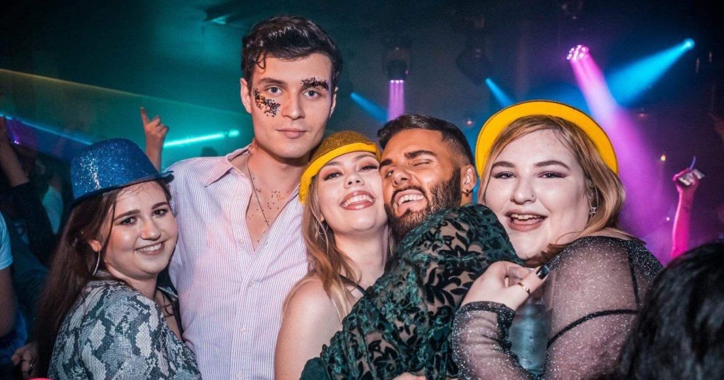 Image may contain: Night Life, Apparel, Clothing, Hat, Disco, Night Club, Party, Club, Person, Human
