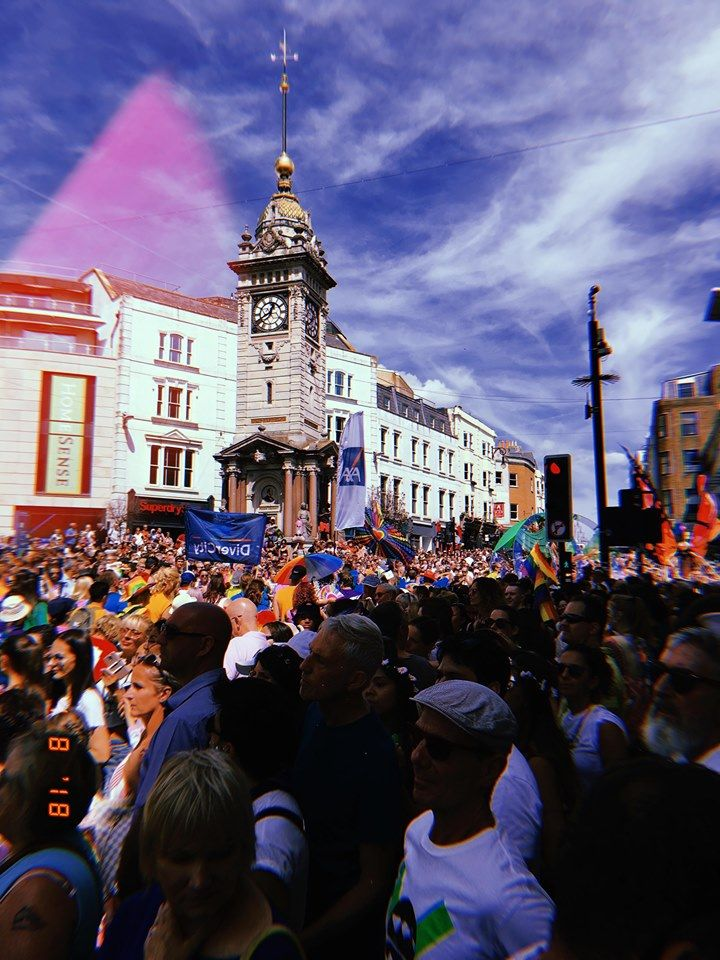 Image may contain: Urban, Town, Downtown, City, Accessory, Sunglasses, Accessories, Festival, Building, Clock Tower, Architecture, Tower, Crowd, Human, Person