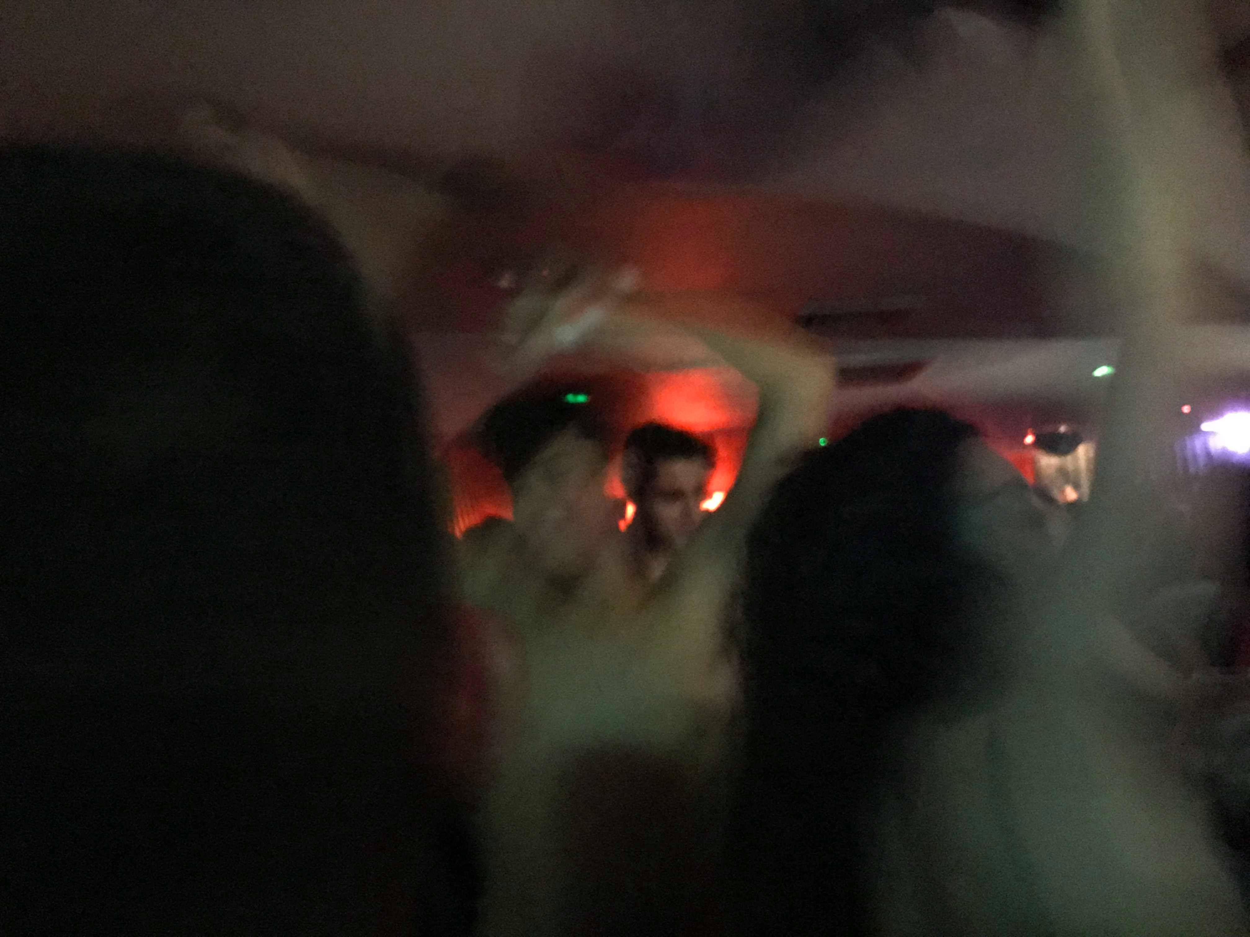 Image may contain: Night Club, Pub, Light, Club, Human, Person