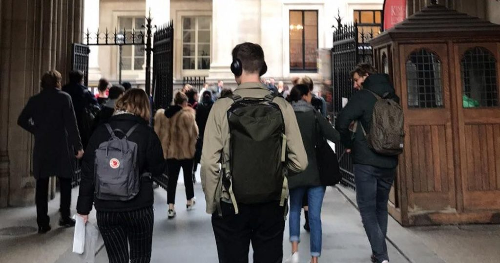 Image may contain: People, Walking, Shoe, Footwear, Pants, Backpack, Bag, Clothing, Coat, Apparel, Jacket, Person, Human, Pedestrian