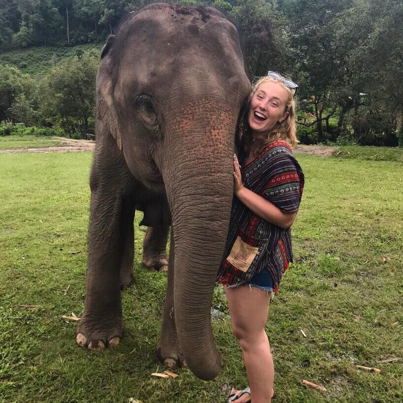 Image may contain: Zoo, Vacation, Face, Female, Apparel, Clothing, Outdoors, Lawn, Park, Tree, Grass, Vegetation, Plant, Person, Human, Wildlife, Elephant, Mammal, Animal