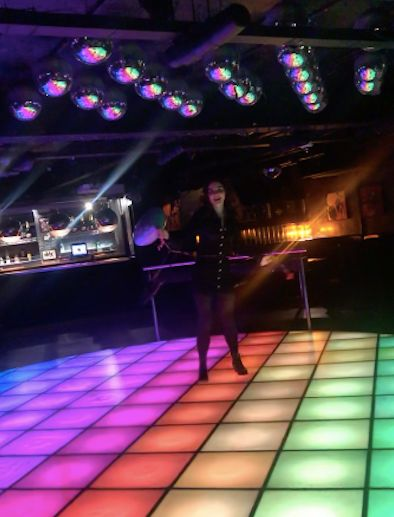 Image may contain: Disco, Night Club, Person, Human, Club, Lighting