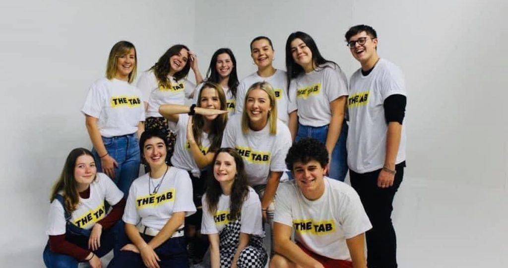 Photo of students smiling in Tab logo t-shirts