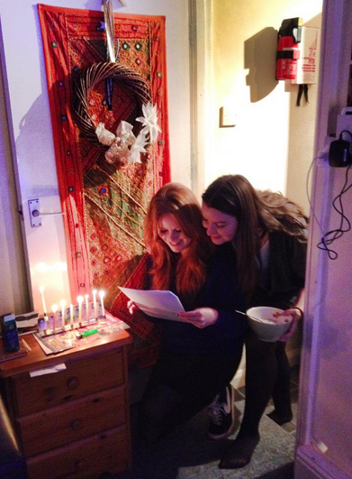 Housemate and I, reading the blessings in Hebrew. (I can only read it phoentically)