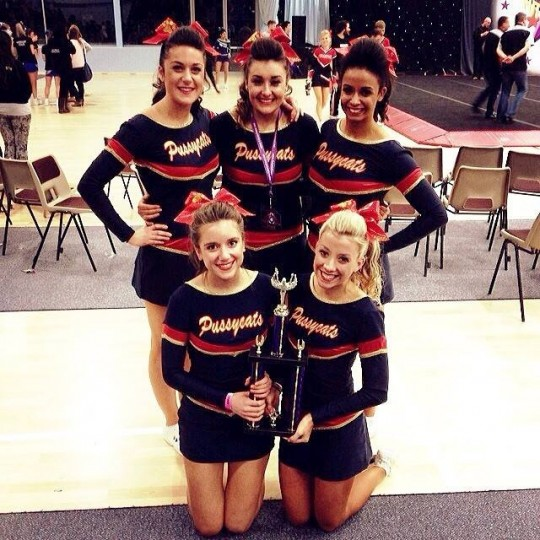 Cheerleading with trophy