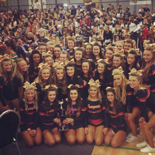 all the cheerleading squad with the trophie