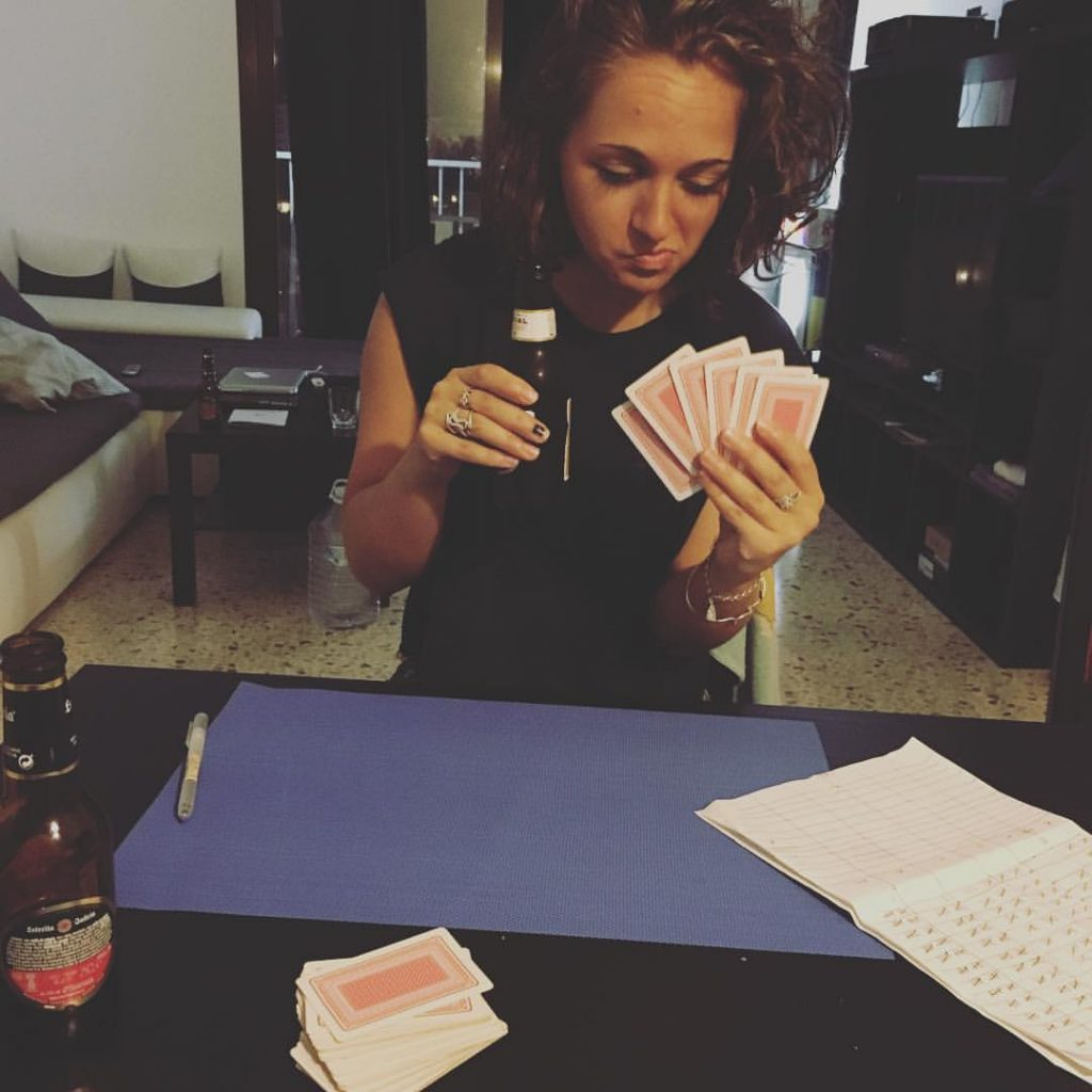 Girl with beer and cards