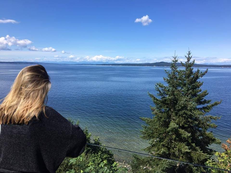 Image may contain: Landscape, Fir, Abies, Coast, Hair, Vegetation, Land, Sea, Ocean, Tree, Plant, Shoreline, Water, Outdoors, Nature, Female, Woman, Teen, Child, Blonde, Person, Human, Kid, Girl