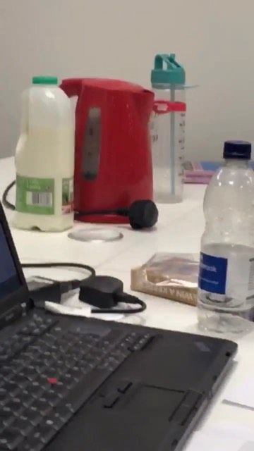 Image may contain: Laptop, Drink, Beverage, Bottle, Computer Hardware, Keyboard, Computer Keyboard, Hardware, Computer, Electronics, Pc