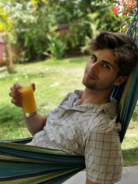 Image may contain: Yard, Nature, Outdoors, Chair, Hammock, Human, Person, Juice, Beverage, Drink, Furniture