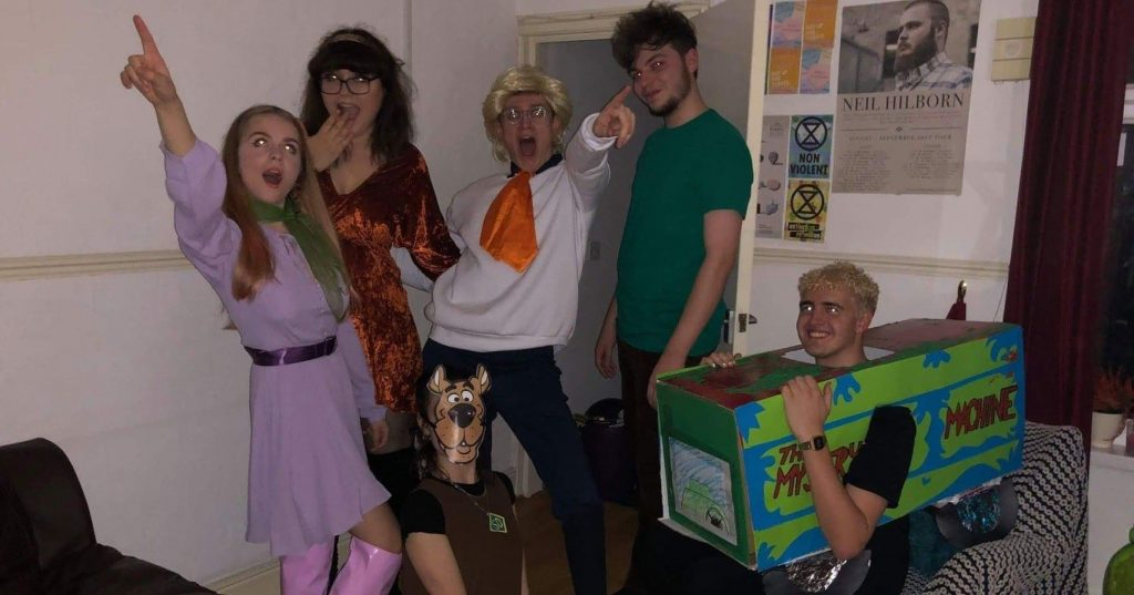 Image may contain: Box, Clothing, Apparel, Human, Person