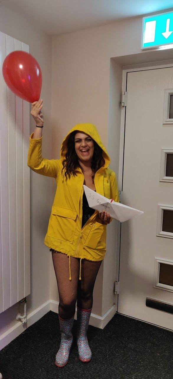 Image may contain: Door, Raincoat, Person, Human, Coat, Apparel, Clothing