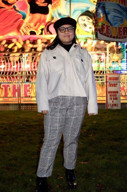 Image may contain: Overcoat, Pants, Jacket, Coat, Human, Person, Apparel, Clothing
