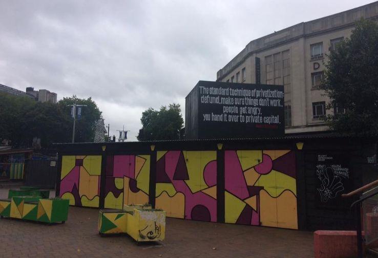 Image may contain: Town, Urban, City, Building, Graffiti, Art