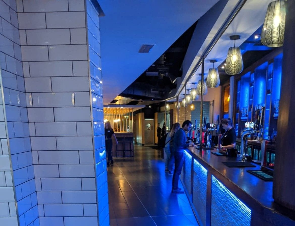 Image may contain: Bar Counter, Restaurant, Lighting, Pub, Floor, Flooring, Person, Human