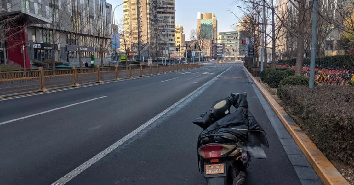 Image may contain: Freeway, High Rise, Moped, Vespa, Vehicle, Motorcycle, Transportation, Motor Scooter, Street, Urban, Building, City, Town, Road