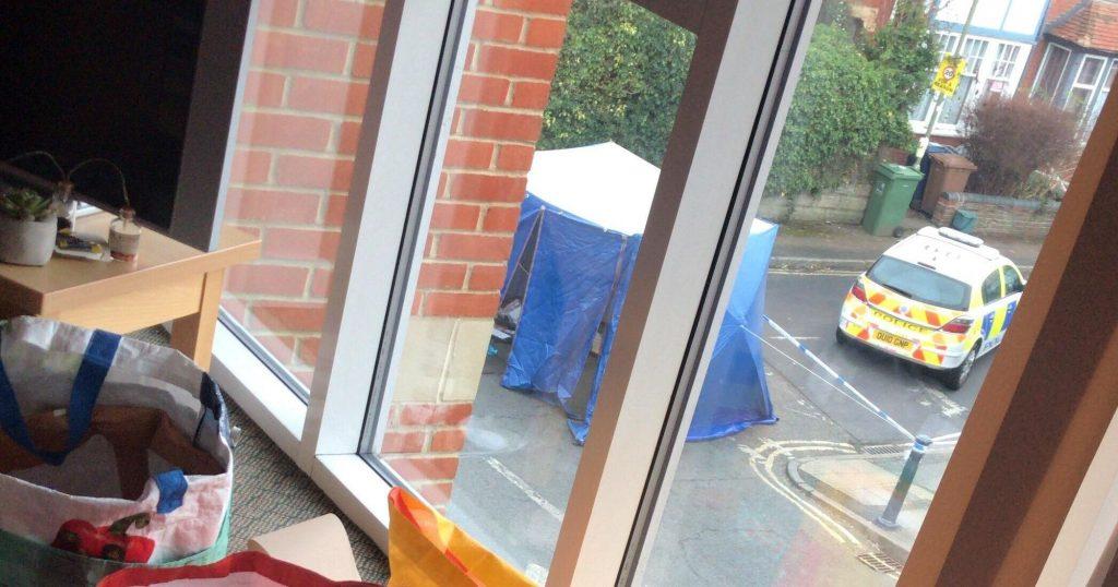 Image may contain: Sliding Door, Footwear, Window, Door, Apparel, Clothing