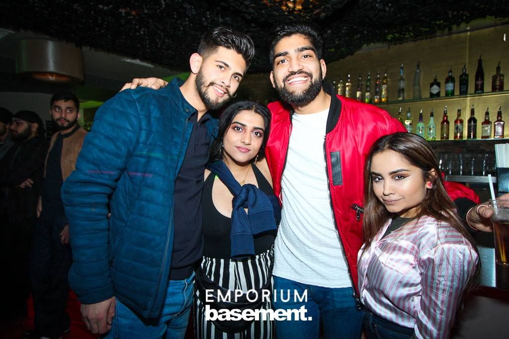 Image may contain: Face, Pub, Bar Counter, People, Coat, Apparel, Jacket, Clothing, Dating, Party, Night Club, Club, Person, Human