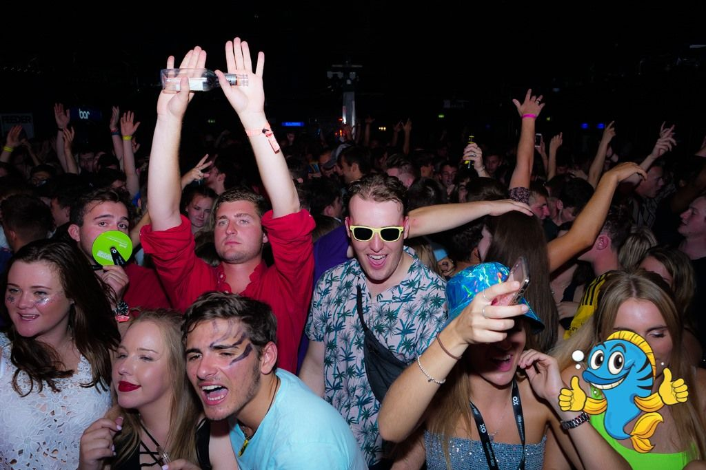 Image may contain: Night Club, Leisure Activities, Club, Audience, Crowd, Party, Night Life, Accessories, Accessory, Sunglasses, Human, Person