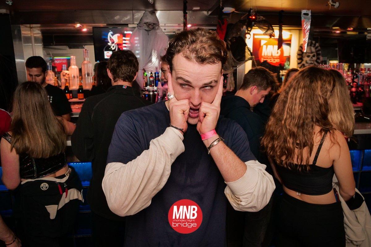 Image may contain: Club, Night Life, Bar Counter, Pub, Human, Person