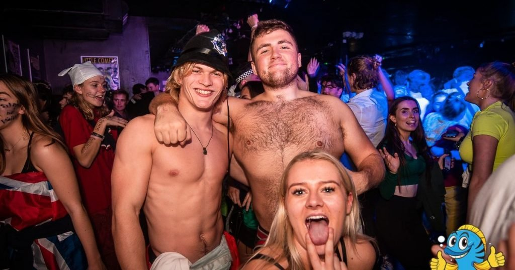 Image may contain: Crowd, Night Club, Face, Club, Night Life, Party, Human, Person, Skin