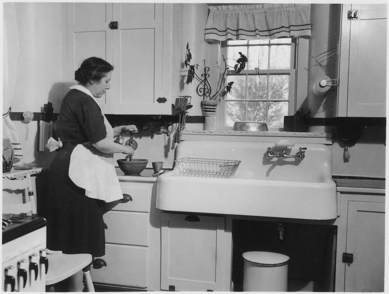 lossy-page1-791px-No_original_caption._(Woman_cooking_in_a_kitchen.)_-_NARA_-_513406.tif