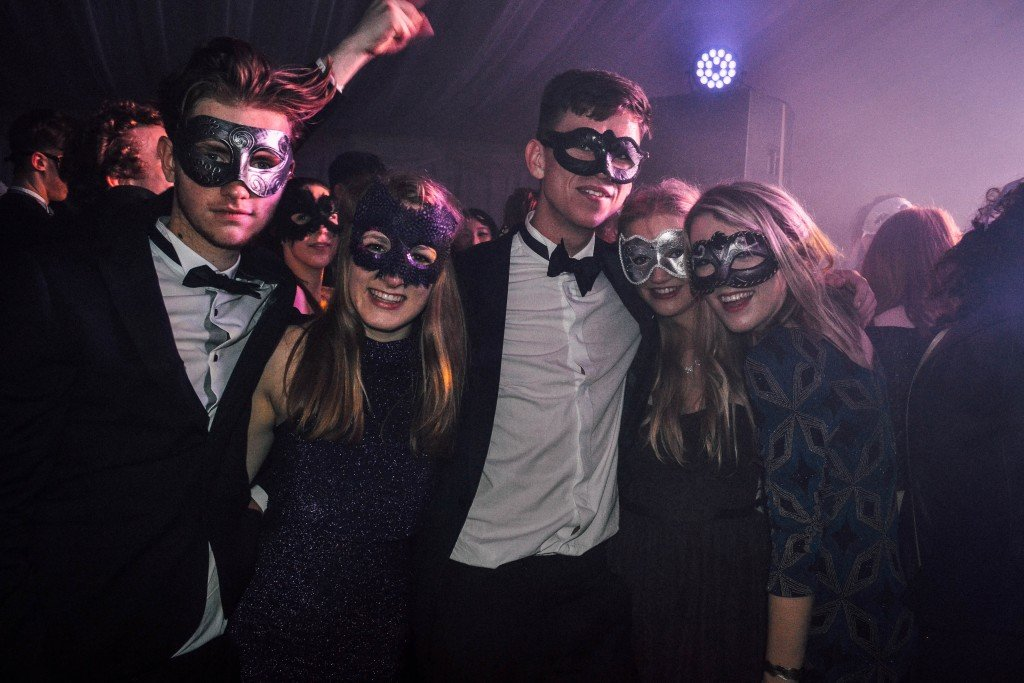 Some of the masked revellers