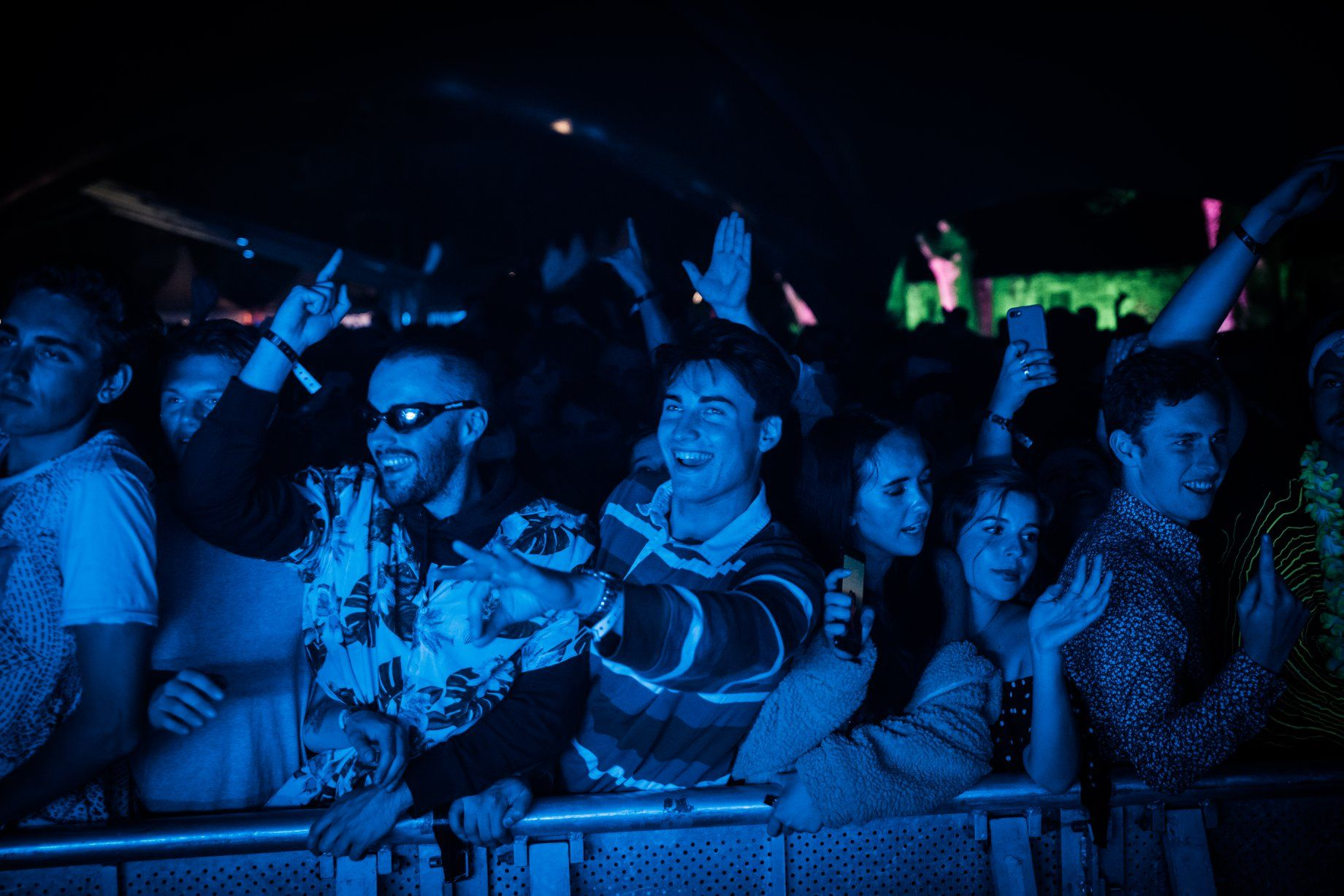 Image may contain: Night Club, Lighting, Audience, Crowd, Club, Night Life, Human, Person